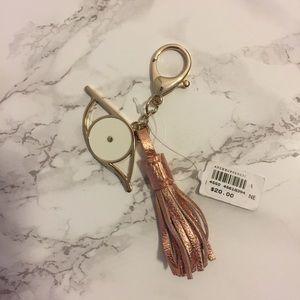 Anthropologie Accessories - Anthropologie Rose Gold Tassle Eye Charm Keychain